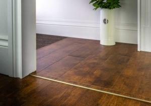 laminate door threshold with matching strip with antique brass surround