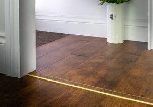 laminate door threshold with matching strip with brass surround